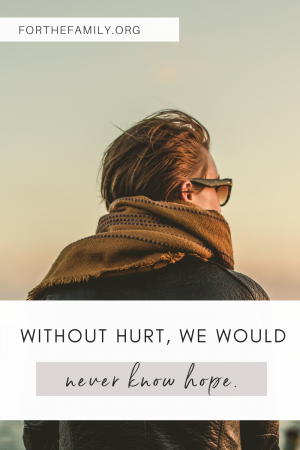 Without Hurt, We Would Never Know Hope. forthefamily.org. person staring off at sea stock image.