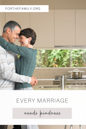 """""""Every Marriage Needs Kindness"""" - stock image of copuple hugging in a kitchen."""